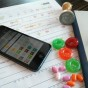 image of a smartphone with mySugr apps and a colorful printed report