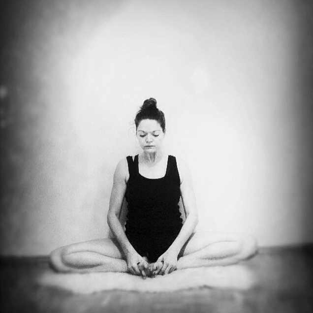 Artistic image of Marlis focusing on her breath during yoga
